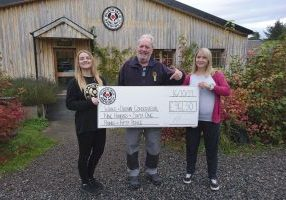 WDC's Charlie Phillips receives donation cheque from Black Isle Brewery